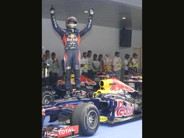 Red-Bull-driver-Sebastian-Vettel-of-Germany-stands-on-his-car-as-he-celebrates-his-win-at-the-Indian-Formula-One-Grand-Prix-at-the-Buddh-International-Circuit-in-Noida-AP-Photo-Mark-Baker