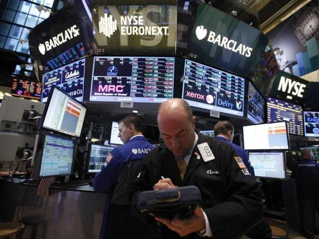 Traders-work-on-the-floor-of-the-New-York-Stock-Exchange-following-its-reopening-in-New-York-Reuters-Photo