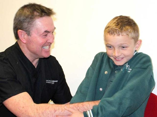 Director-of-Monash-Heart-Ian-Meredith-interacts-with-10-year-old-Matthew-Gaythorpe-as-Australian-doctors-hailed-what-they-described-as-a-world-first-surgical-treatment-for-the-boy-suffering-from-a-rare-disease-that-sends-his-blood-pressure-soaring-and-triggered-a-stroke-in-Melbourne-AFP-Monash-Heart-Institute