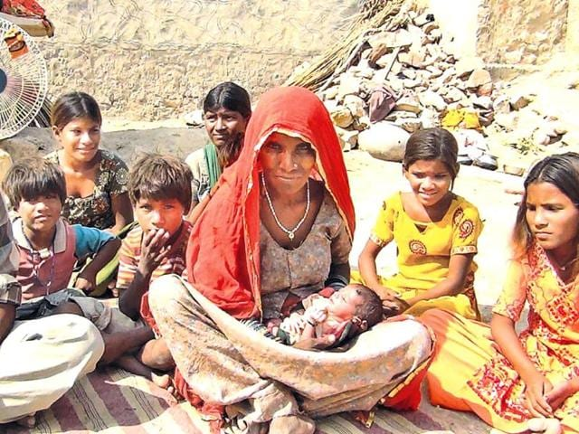 The-32-year-old-woman-gives-birth-to-16-kids-in-17-yrs-with-her-new-born-and-other-children-in-Barmer-HT-photo