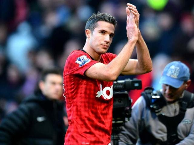 Manchester-United-s-Dutch-forward-Robin-van-Persie-leaves-the-field-after-winning-2-1-against-Arsenal-during-their-the-English-Premier-League-football-match-at-Old-Trafford-in-Manchester-northwest-England-AFP-Photo