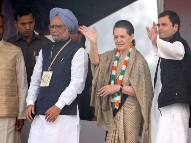 Prime-Minister-Manmohan-Singh-and-Congress-party-general-secretary-Rahul-Gandhi-join-Congress-president-and-UPA-chairperson-Sonia-Gandhi-as-she-waves-towards-supporters-during-a-party-rally-at-Ram-Lila-grounds-in-New-Delhi-AFP-Sajjad-Hussain