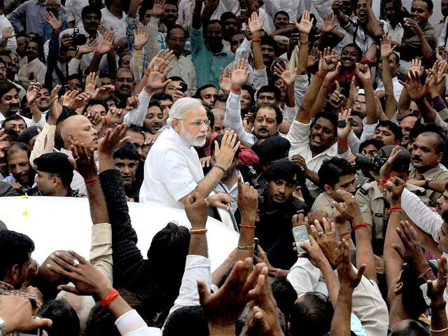 Gujarat-CM-Narendra-Modi-waves-to-his-supporters-during-his-visit-to-Patna-PTI-Photo