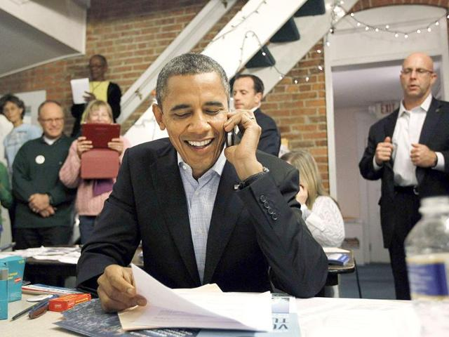US-President-Barack-Obama-makes-calls-to-volunteers-who-have-helped-his-re-election-cause-from-the-German-Village-election-campaign-office-in-Columbus-Ohio-Reuters-Jason-Reed