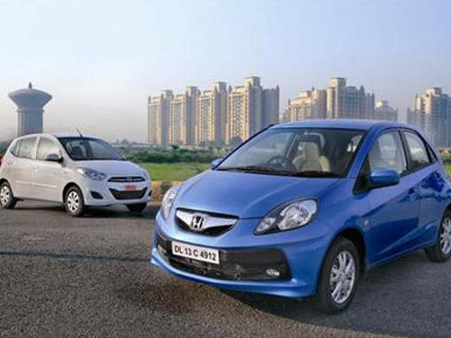 Both these automatic hatchbacks are very easy to live with. But which one is better?