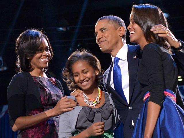 US-President-Barack-Obama-accompanied-by-First-Lady-Michelle-and-daughters-Sasha-and-Malia-appears-on-stage-on-election-night-in-Chicago-Illinois-AFP-photo-Jewel-Samad
