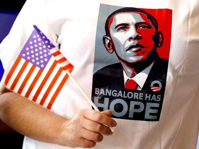 A-supporter-of-President-Barack-Obama-holds-a-flag-and-sports-a-T-shirt-which-has-a-portrait-of-Obama-and-a-phrase-that-reads-Bangalore-has-hope-during-a-screening-of-US-elections-coverage-organized-at-a-restaurant-over-breakfast-in-Bangalore-AP-Photo-Aijaz-Rahi
