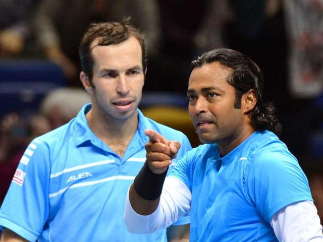 Leander-Paes-R-and-Czech-Republic-s-Radek-Stepanek-L-celebrate-their-victory-over-Spain-s-Marc-Lopez-and-Spain-s-Marcel-Granollers-during-their-group-A-doubles-match-in-the-round-robin-stage-on-the-fourth-day-of-the-ATP-World-Tour-Finals-tennis-tournament-in-London-AFP-Photo