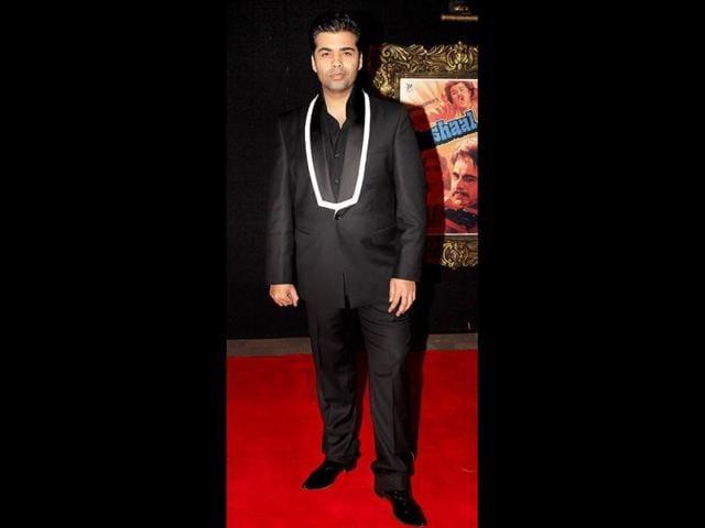 Karan-Johar-in-his-usual-black-ensemble-Photo-Yogen-Shah