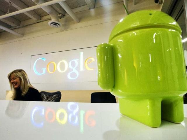 A-Google-Android-figurine-sits-on-the-welcome-desk-as-employee-Tracy-McNeilly-smiles-at-the-new-Google-office-in-Toronto-November-13-2012-Reuters-Mark-Blinch