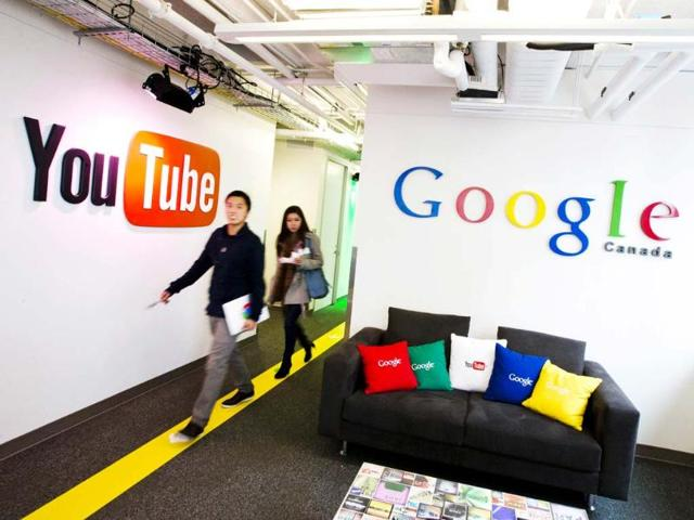 People-walk-by-a-YouTube-sign-at-the-new-Google-office-in-Toronto-November-13-2012-Reuters-Mark-Blinch