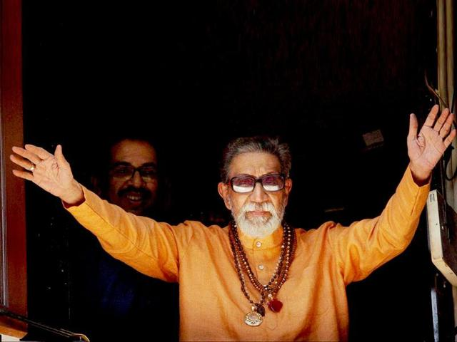 In-this-file-photo-Shiv-Sena-supremo-Bal-Thackeray-waves-at-party-workers-gathered-outside-his-residence-Matoshree-in-Mumbai-PTI