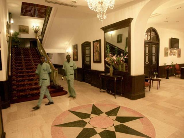 Hotel-employees-walk-inside-the-Grand-Holiday-Villa-hotel-in-the-Sudanese-capital-Khartoum-Photo-AFP-Ashraf-Shazly