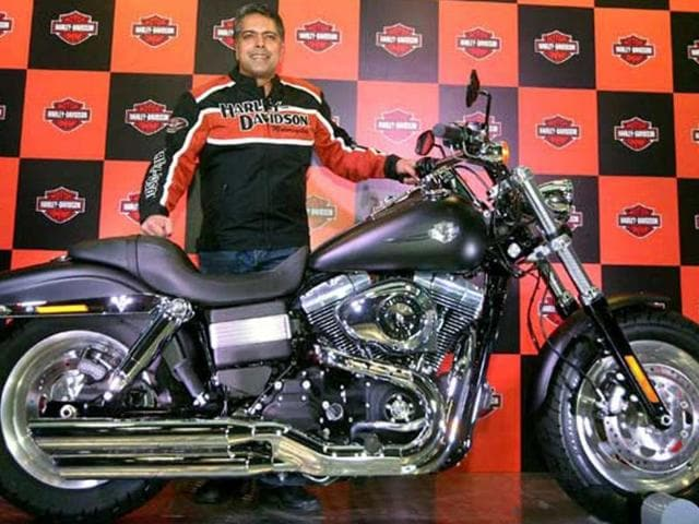 Anoop-Prakash-managing-director-Harley-Davidson-India-poses-with-the-Fat-Bob-motorcycle-during-its-launch-in-New-Delhi-PTI-Photo