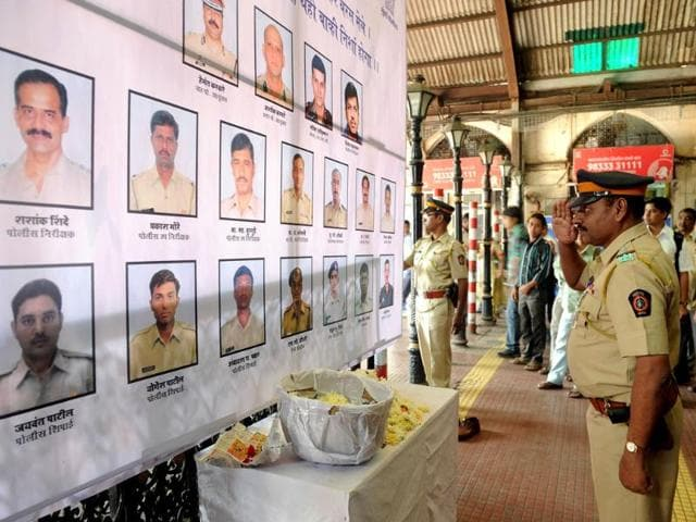 A-police-officer-pays-his-respects-to-police-and-uniformed-personnel-who-lost-their-lives-in-2008-terror-attacks-outside-a-railway-station-in-Mumbai-AFP-Indranil-Mukherjee