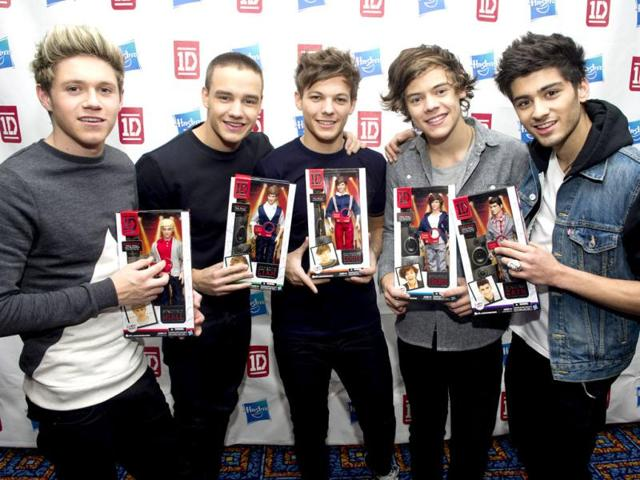 Members-of-worldwide-musical-sensation-One-Direction-L-R-Niall-Horan-Liam-Payne-Louis-Tomlinson-Harry-Styles-and-Zayn-Malik-pose-with-their-Hasbro-dolls-at-a-press-event-in-New-York-AP-Photo