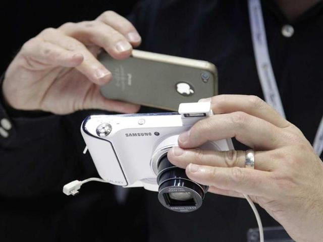 A-man-takes-a-picture-of-a-Samsung-Galaxy-Camera-during-press-preview-day-before-the-official-start-of-the-IFA-consumer-electronics-fair-in-Berlin-Credit-Reuters-Tobias-Schwarz-File