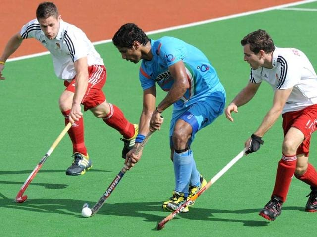 Rupinder-Pal-Singh-fights-his-way-between-Mark-Gleghorne-L-and-Alastair-Brogdon-R-of-England-during-a-match-between-India-and-England-at-the-Mens-Hockey-Champioships-Trophy-in-Melbourne-AFP