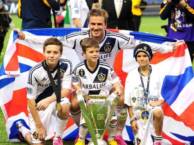 fe3e388413 David-Beckham -poses-with-his-sons-Brooklyn-L-Cruz-C-and-Romeo-and-the-MLS-Trophy-after-the-Los-Angeles- Galaxy-beat-Houston-Dynamo-3-1-in-the-Major-League- ...