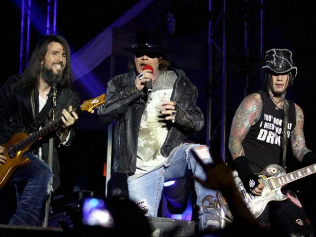 Guitarist-Ron-Bumblefoot-Thal-Lead-Vocalist-Axl-Rose-and-DJ-Ashba-of-Guns-N-Roses-performs-during-a-concert-in-Mumbai-PTI-Photo