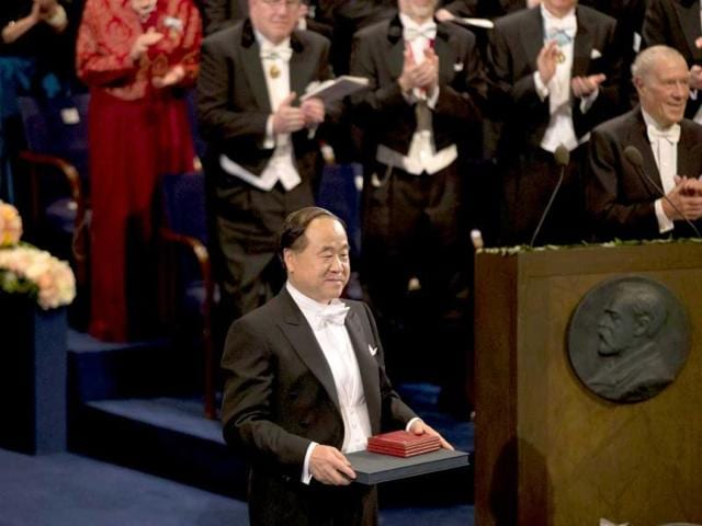 The-2012-Nobel-Prize-Laureate-for-Literature-China-s-Mo-Yan-stands-to-the-applause-after-receiving-his-Nobel-Prize-from-Sweden-s-King-Carl-XVI-Gustaf-not-pictured-during-the-Nobel-Prize-award-ceremony-at-the-Stockholm-Concert-Hall-in-Stockholm-AP-Photo