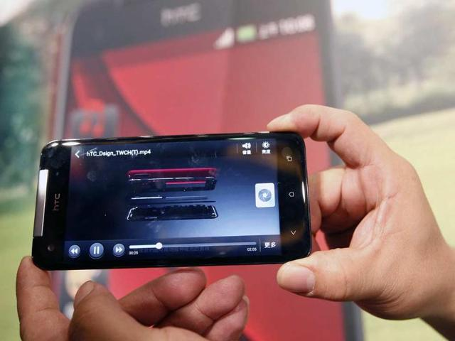 The-new-HTC-Butterfly-smartphone-is-on-display-during-a-news-conference-to-launch-the-product-in-Taipei-December-11-2012-The-smartphone-features-a-5-inch-full-HD-1080p-display-and-was-launched-on-Tuesday-at-the-price-of-NT-22-900-788-Reuters-Pichi-Chuang