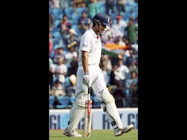 Alastair-Cook-walks-back-to-pavilion-after-losing-his-wicket-on-the-first-day-of-fourth-cricket-test-match-between-England-and-India-in-Nagpur-PTI-Photo