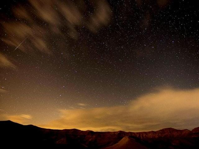 Geminid-meteor-streaks-are-seen-above-the-Judean-desert-near-the-Israeli-Kibbutz-of-Ein-Gedi-early-December-14-2012-The-meteor-display-known-as-the-Geminid-meteor-shower-because-it-appears-to-radiate-from-the-constellation-Gemini-is-thought-to-be-the-result-of-debris-cast-off-from-an-asteroid-like-object-called-3200-Phaethon-The-shower-is-visible-every-December-AFP-Photo