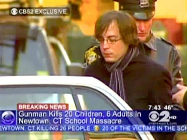 Ryan-Lanza-the-brother-of-Sandy-Hook-Elementary-School-shooter-Adam-Lanza-is-escorted-into-a-cruiser-in-Hoboken-New-Jersey-AP-Photo-WCBS-TV