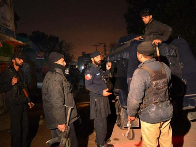 Pakistani-security-personnel-gather-near-the-airport-after-a-rocket-attack-on-an-airport-in-Peshawar-AFP-Photo