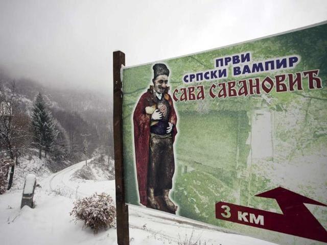 December-3-2012-shows-a-road-sign-that-says-First-Serbian-vampire-Sava-Savanovic-near-the-western-Serbian-village-of-Zarozje-some-140km-from-Belgrade-Photo-AFP-Dalibor-Danilovic