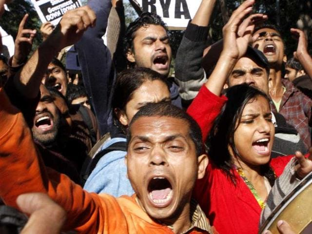Indian-police-officers-lock-the-gate-of-the-police-station-during-a-protest-condemning-the-gang-rape-of-a-23-year-old-student-on-a-moving-bus-on-late-Sunday-in-New-Delhi-The-anger-found-reflection-not-just-in-street-demonstrations-but-also-in-Parliament-AP-Photo