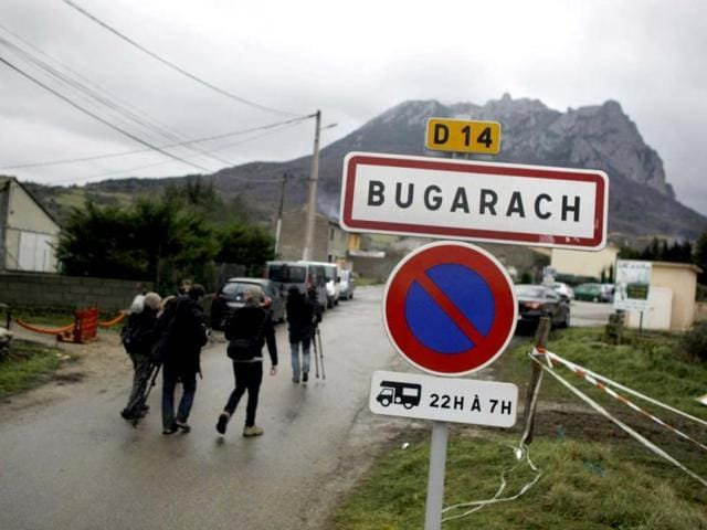 Pic-de-Bugarach-mountain-rises-above-the-small-town-of-Bugarach-France-Although-the-long-expected-end-of-the-Mayan-calendar-has-come-the-New-Age-enthusiasts-have-steered-clear-from-the-sleepy-French-town-of-Bugarach-which-gave-some-locals-a-chance-to-joke-about-the-end-of-the-world-legends-that-surround-the-area-AP-Marko-Drobnjakovic