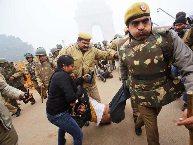 Police-detain-a-demonstrator-in-front-of-the-India-Gate-during-a-protest-demanding-speedy-justice-and-stringent-punishment-for-the-accused-in-Sunday-s-gang-rape-Reuters-Photo