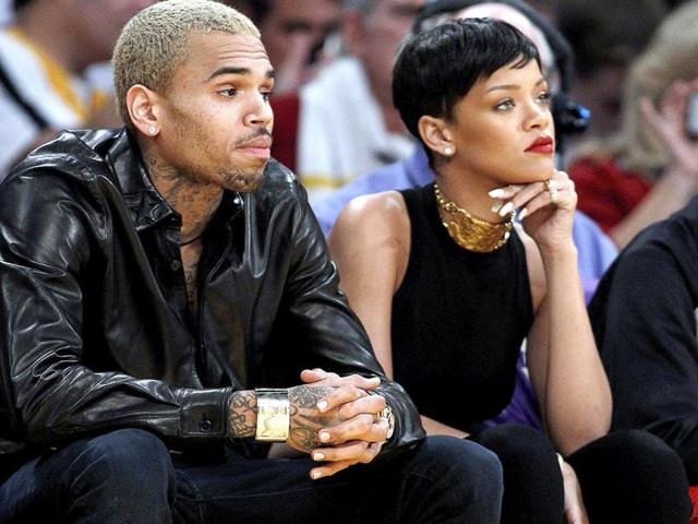Rihanna-and-Chris-Brown-arrived-in-the-arena-in-the-same-car-but-got-out-of-the-vehicle-separately-AP-PHOTO