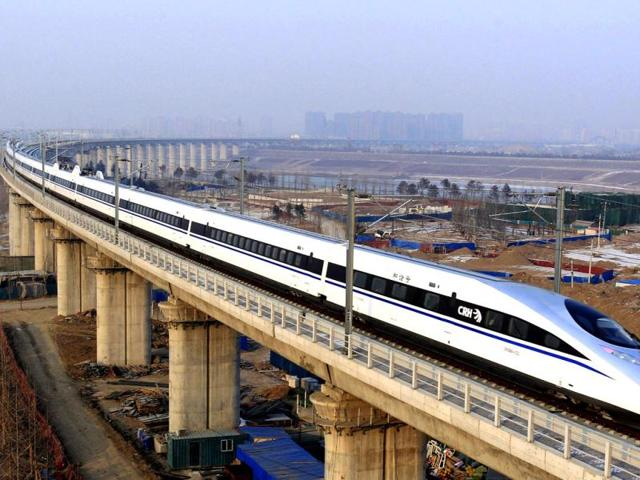 A-bullet-train-passes-over-Yongdinghe-Bridge-in-Beijing-China-has-opened-the-world-s-longest-high-speed-rail-line-which-runs-2-298-kilometers-from-Beijing-in-the-north-to-Guangzhou-AP-Photo-Xinhua