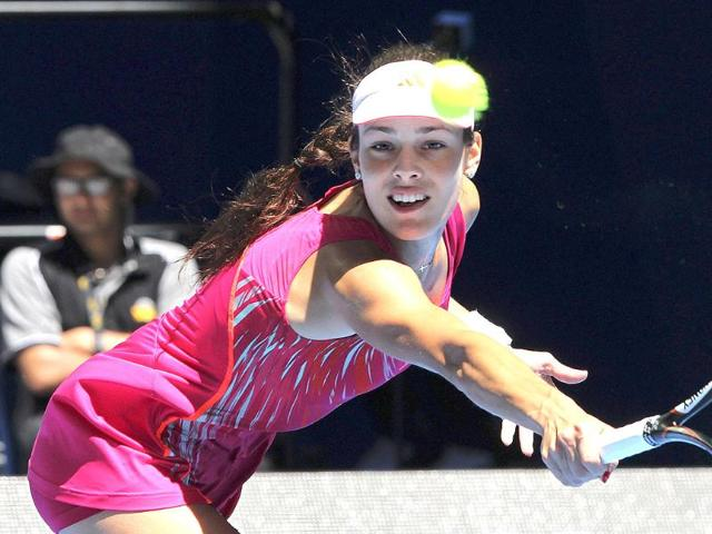 Ana-Ivanovic-of-Serbia-hits-a-return-to-Francesca-Schiavone-of-Italy-during-their-women-s-singles-match-at-the-Hopman-Cup-tennis-tournament-in-Perth-Reuters-Stringer