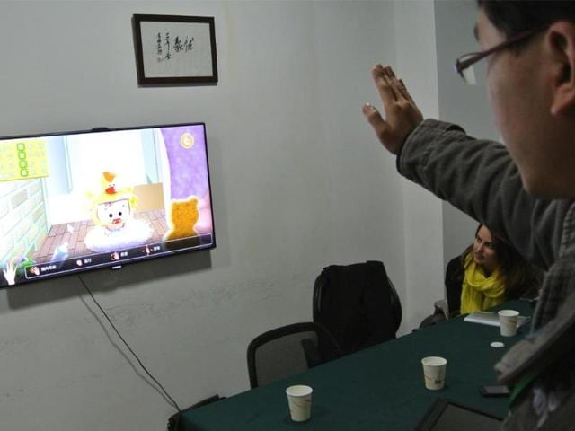 A-developer-tests-a-game-for-children-in-an-office-in-Chengdu-southwest-China-s-Sichuan-province-on-December-12-2012-Photo-AFP-Sebastien-Blanc