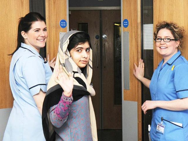 Pakistani-schoolgirl-Malala-Yousafzai-bids-goodbye-to-the-staff-of-the-Queen-Elizabeth-Hospital-in-Birmingham-AFP-Queen-Elizabeth-Hospital