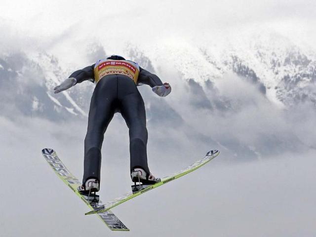 Austria-s-Gregor-Schlierenzauer-soars-through-the-air-during-his-competition-jump-of-the-third-stage-of-the-four-hills-ski-jumping-tournament-in-Innsbruck-Austria-Photo-AP-Matthias-Schrader