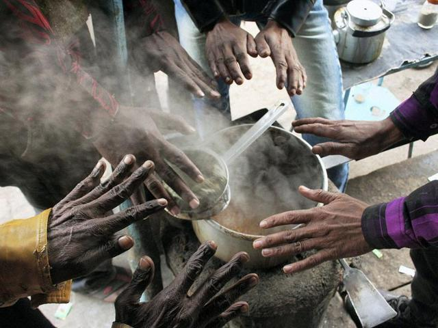 People-warm-themselves-at-a-tea-stall-during-a-cold-day-in-Varanasi-PTI