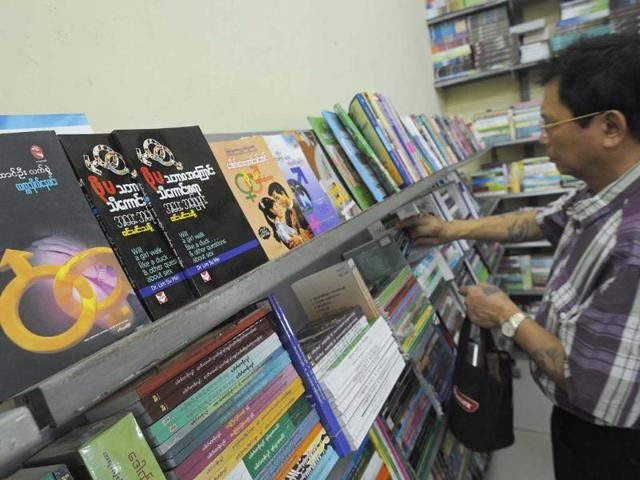 This-picture-taken-on-January-5-2013-shows-a-man-browsing-the-shelves-in-a-book-shop-where-Myanmar-sex-education-books-are-on-display-in-Yangon-Photo-AFP-Soe-Than-Win