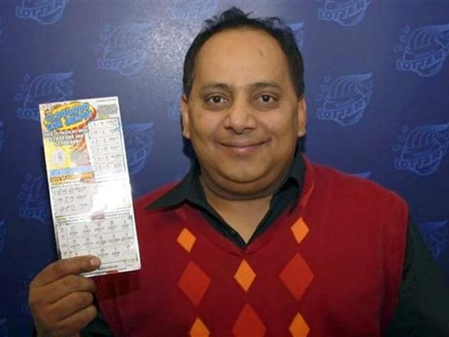 This-undated-photo-provided-by-the-Illinois-Lottery-shows-Urooj-Khan-46-of-Chicago-s-West-Rogers-Park-neighborhood-posing-with--the-winning-lottery-ticket-AP-Photo