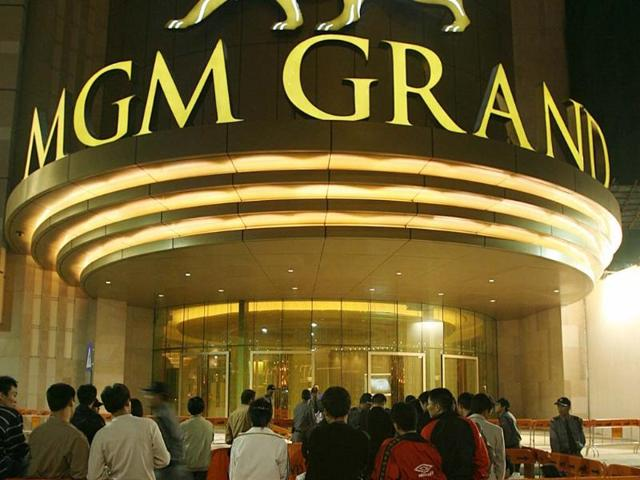 People-start-to-queue-prior-to-the-opening-of-the-MGM-Grand-Macau-18-December-2007-MGM-plans-a-second-casino-in-Macau-with-1-600-hotel-rooms-500-gaming-tables-and-2-500-slot-machines-Photo-AFP-Mike-Clarke