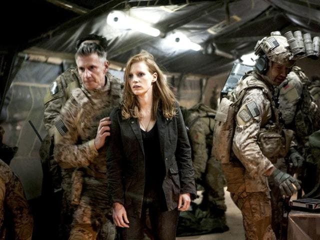 In this photo released by Columbia Pictures Industries, Inc., Jessica Chastain (C) plays a role in Columbia Pictures