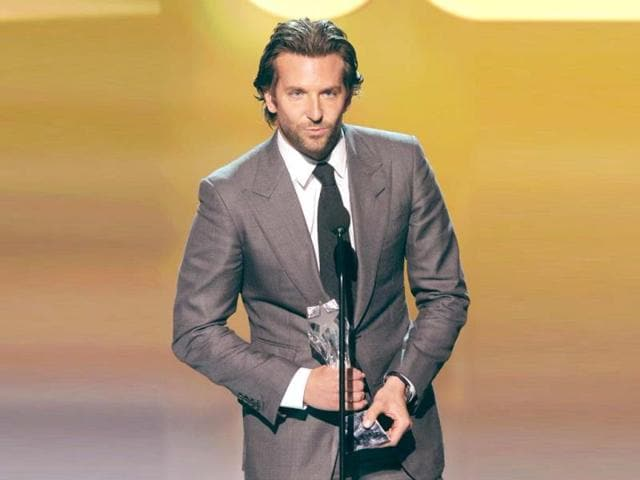 Actor-Bradley-Cooper-accepts-the-Best-Actor-in-a-Comedy-Award-for-Silver-Linings-Playbook-onstage-at-the-18th-Annual-Critics-Choice-Movie-Awards-held-at-Barker-Hangar-in-Santa-Monica-California-AFP-Photo