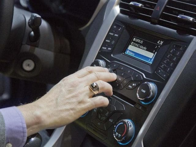 An-industry-affiliate-tests-out-Ford-s-SYNC-connection-and-entertainment-system-inside-a-Ford-Fusion-at-the-Consumer-Electronics-Show-Wednesday-Jan-9-2013-in-Las-Vegas-Ford-s-SYNC-connects-the-car-stereo-and-navigation-system-to-a-user-s-mobile-device-Photo-AP-Julie-Jacobson