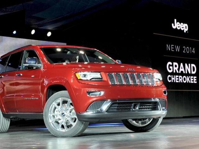 The 2014 Jeep Grand Cherokee is introduced at the North American International Auto Show in Detroit. REUTERS/James Fassinger