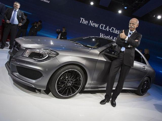 Mercedes Chairman of the Board Dr. Dieter Zetsche poses for a photo at the launch of the company's CLA class car on the eve of the 2013 North American International Auto Show in Detroit, Michigan. AFP PHOTO / Geoff ROBINS