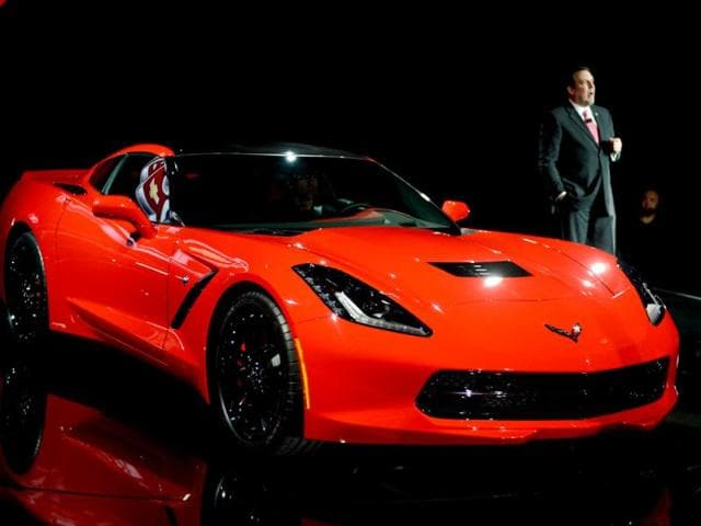 President of GM North America, and the redesigned 2014Chevrolet Corvette Stingray introduced the night before press previews start at the 2013 North American International Auto Show in Detroit. AFP PHOTO/Stan HONDA